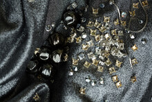 Metal Beads, Silver And Golden Objects On Textile