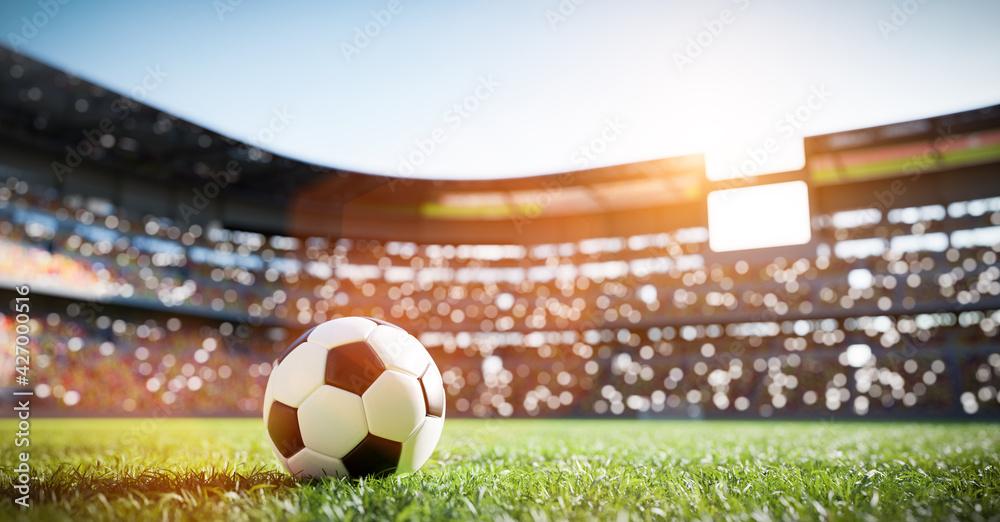 Fotografia Football soccer ball on grass field on stadium