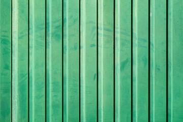 soiled striped green metal sheet