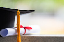 Close-up Of A Mortarboard And Degree Certificate Put On Table. Education Stock Photo