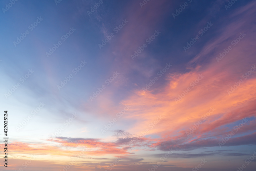 Fototapeta Beautiful dramatic and colorful sky at sunset over the mountains