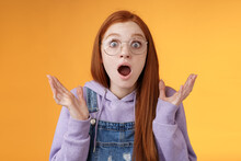Close-up Shocked Sensitive Concerned Young Panicking Redhead Woman Worry Drop Jaw Gasping Raise Hands Spread Freak Out Stare Surprised Emotional Reacting Incredible News, Orange Background