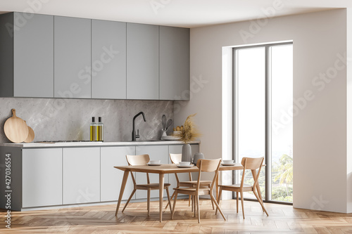 Foto Corner view of bright kitchen room interior with panoramic window