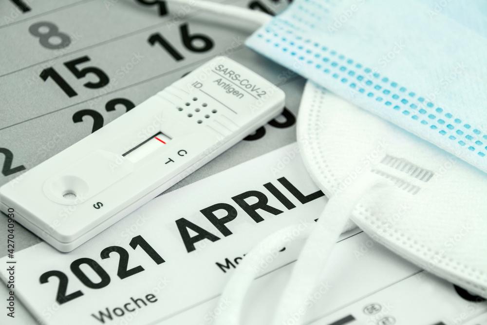 Leinwandbild Motiv - PhotoSG : Corona Antigen Schnelltest mit Kalender April 2021 und Masken