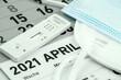 Leinwandbild Motiv Corona Antigen Schnelltest mit Kalender April 2021 und Masken