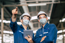 Engineer Worker Men Teamwork Wear Face Mask During Service Working In Factory To Check Prevent Covid-19 Virus Air Dust Pollution And For Good Healthy.
