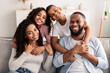 Portrait of happy black family smiling at home