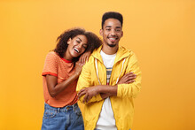 Awesome When Boyfriend Is Best Friend. Portrait Of Charming Friendly African American Woman Leaning On Guy Touching His Shoulder Feeling Happy They Together And She Can Rely On Posing Orange Wall