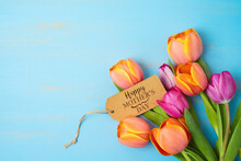 Happy Mother's Day Concept With Beautiful Tulip Flowers  On Wooden Background With Copy Space