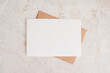 canvas print picture - Blank card mock up. Layout of sheet of paper on craft envelope and marble texture. Horizontal canvas template for greeting, wedding cards, invitations. Natural beige colors.