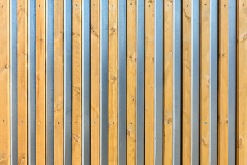 the metal surface is decorated with wooden slats as a natural background