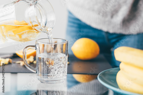 Obraz Woman making lemonade at home. - fototapety do salonu
