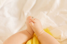 Cute Toddler Lies In Bed With Yellow Towel After Bathing