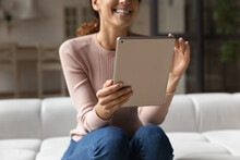 Modern Tech At Home. Close Up Of Smiling Young Lady Hold Electronic Tablet Pc Use Entertainment App Enjoy Video Game. Happy Female Sit On Couch Touch Modern Pad Screen Do Shopping On Ecommerce Website