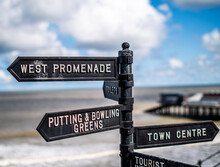 Close Up Of Direction Signs For People, Visiting The Seaside Town Of Cromer On The North Norfolk Coast