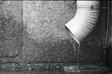 Downspout On Wall Background