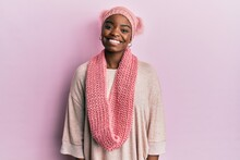 Young African American Woman Wearing Wool Hat And Winter Scarf With A Happy And Cool Smile On Face. Lucky Person.
