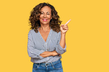 Middle Age Hispanic Woman Wearing Casual Clothes Smiling Happy Pointing With Hand And Finger To The Side