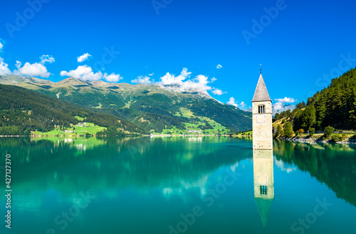 Tela Submerged Bell Tower of Curon on Lake Reschen in South Tyrol, Italy