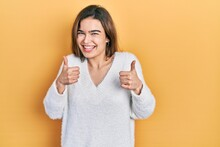 Young Caucasian Girl Wearing Casual Clothes Success Sign Doing Positive Gesture With Hand, Thumbs Up Smiling And Happy. Cheerful Expression And Winner Gesture.