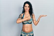 Young Woman Wearing Bindi And Traditional Belly Dance Clothes Showing Palm Hand And Doing Ok Gesture With Thumbs Up, Smiling Happy And Cheerful