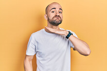 Young Bald Man Wearing Casual White T Shirt Cutting Throat With Hand As Knife, Threaten Aggression With Furious Violence