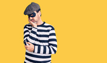 Middle Age Handsome Man Wearing Burglar Mask Thinking Looking Tired And Bored With Depression Problems With Crossed Arms.