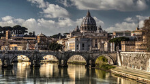 Ponte Sant Angelo, Originally The Aelian Bridge Or Pons Aelius And The Papal Basilica Of Saint Peter In The Vatican, Or Simply Saint Peters Basilica In Background.