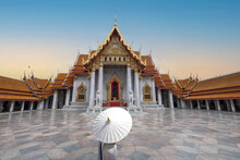 Marble Temple Bangkok With A Beautiful Lady In Front Holding An Umbrella