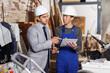 Male designer explaining professional builder details of plan at construction site