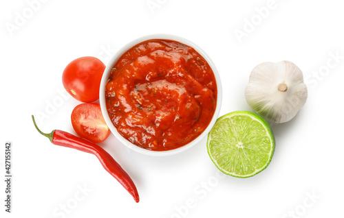 Bowl of tasty salsa sauce and ingredients on white background - fototapety na wymiar