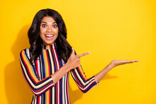 Portrait Of Pretty Astonished Dark Skin Person Indicate Finger Hand Palm Hold Empty Space Isolated On Yellow Color Background