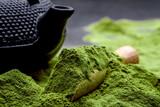 Fototapeta Tulipany - Powdered green tea and set for matcha on black background