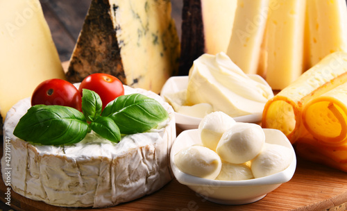 Fotografie, Tablou Different sorts of cheese on kitchen table