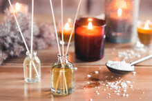 Reed Air Freshener With Candle And Eucalyptus Branches On Tray Indoors, Closeup