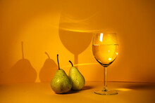 Classic Still Life With Pears, White Wine On A Bright Yellow Background. Advertising Of Wineries And Restaurants. Photo For The Author's Culinary Blog. Saumillier. Wine Tasting.