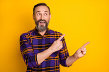 Portrait Of Attractive Funky Cheerful Guy Demonstrating Copy Empty Space Ad Isolated Over Bright Yellow Color Background