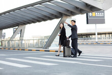 Successful Business People Travelling From Airport