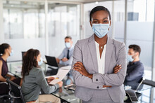 Mature Black Businesswoman With Face Mask Standing At Office