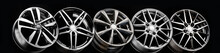 Black Beautiful Sports Alloy Wheels Forged Stand In A Row On A Black Background