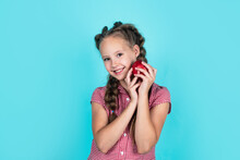 Happy Girl Holding Apples From Garden. Kid Hold Fresh Fruit. Child Eating Red Apple. Summer Healthy Food. Vegetarian Dieting. Fruits At Fall Harvest. Healthy Nutrition In Autumn. Spring Collection