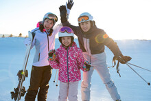 Happy Young Family Relaxing In Ski Resort