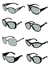 Collection Of Black And Gray Silhouettes Of Sunglasses On A White Background.