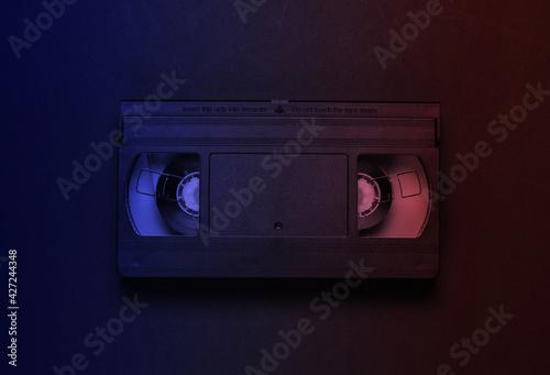 Fotografia, Obraz Video cassette in neon light. Retro storage media, videotape. 80s