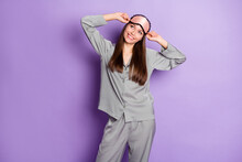 Portrait Of Charming Dreamy Cheerful Girl Wearing Pajama Awakening Posing Isolated Over Violet Purple Color Background