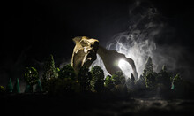 Animal Bone In Dark Halloween Night With Fog And Light On Background / Selective Focus And Space For Text. Abstract Horror Concept