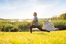 Happy Mature Man Exercising In Park
