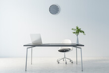 Cold Shadows Interior Design Of Home Office Waork Place With Modern Laptop On Dark Marble Table, Grey Wall Clock On Light Background And Concrete Floor