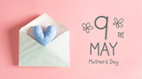 Mother's Day message with a blue heart cushion