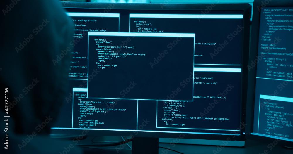 Fototapeta Asian male hacker use laptop